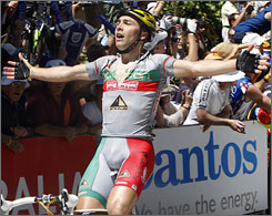 Portugal's Manuel Cardoso raises his arms in victory after winning the third stage of the Tour Down Under.