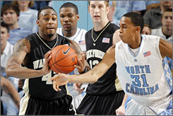 L.D. Williams, left, and Wake Forest handed John Henson and North Carolina their first three-game losing streak under coach Roy Williams.