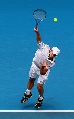Andy Roddick of the USA raps another serve in his victory Friday against Feliciano Lopez of Spain at the Australian Open in Melbourne. Roddick won 6-7 (4-7), 6-4, 6-4, 7-6 (7-3).
