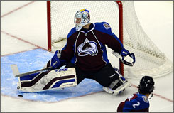 Avalanche goalie Craig Anderson, making a pad save during the first period, stopped 29 Predators shots to help Colorado win its fifth straight game.