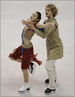 Meryl Davis, left, and Charlie White's Bollywood original dance performance helped the duo extend their lead over Tanith Belbin and Ben Agosto at the U.S. Figure Skating Championships.