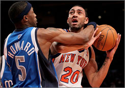 Dallas defender Josh Howard puts the clamps on New York's Jared Jeffries during the Mavs' blowout victory on the road.