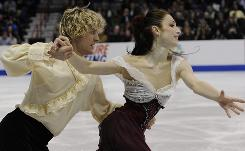 Ice dancers Charlie White and Meryl Davis skate their free dance Saturday.