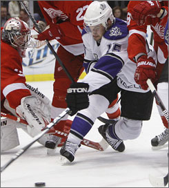 Los Angeles' Brad Richardson fights for control of the puck against Detroit during the first period. Richardson scored the game-winning goal in the third period as the Kings rallied to win 3-2.