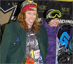 Shaun White and Kelly Clark smile from the podium after winning the men's and women's national championships.