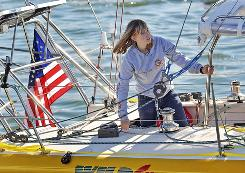 Abby Sunderland, 16, looks out from her sailboat, Wild Eyes, as she leaves for her world record-attempting journey at the Del Rey Yacht Club on Saturday. She will attempt to become the youngest person to complete a nonstop, unassisted solo-journey around the globe.