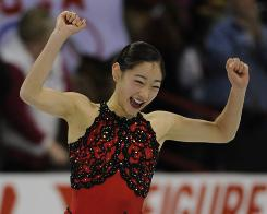 Mirai Nagasu celebrates at the conclusion of Saturday's program. She finished in second place with a total score of 188.78.