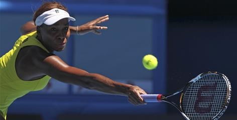 Venus Williams of the USA stretches for a return during her fourth-round victory Monday against Francesca Schiavone of Italy.