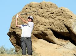 With the desert in the backround, Bubba Watson hits a tee shot on the third hole during the fourth round of the Bob Hope Classic at the Nicklaus Private Course at PGA West.
