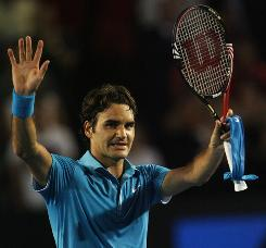Roger Federer thanks the crowd after winning his fourth-round match against Lleyton Hewitt at the Australian Open.