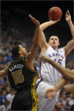Kansas' Cole Aldrich scored 12 points, pulled down 16 rebounds and blocked seven shots as the Jayhawks won their Border Showdown against Keith Ramsey and Missouri.