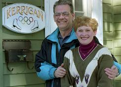 This Feb. 10, 1994 file photo shows Daniel and Brenda Kerrigan, the parents of 1994 figure skating silver medalist Nancy Kerrigan, outside their home in Stoneham, Mass.