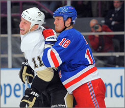 New York Rangers defenseman Marc Staal checks his brother Jordan during the Penguins' win over fading New York.