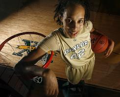 Already known for her dunks in high school, Baylor basketball player Brittney Griner has brought along defense to the Bears, already setting the single-season blocks record only halfway through her freshman season.