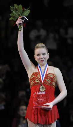 Rachael Flatt waves after receiving her medal after winning the ladies free skate at the U.S. Figure Skating Championships on Saturday.