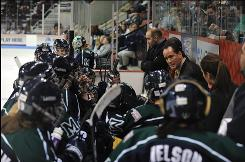 Mercyhurst head women's hockey coach Michael Sisti gives his team a pep talk in the 2009 NCAA Semifinal against Minnesota.