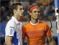 Andy Murray of Britain, left, and Rafael Nadal of Spain walk together at the net after Nadal retired from their Men's singles quarterfinal match at the Australian Open on Tuesday. Nadal retired with a knee injury in the third set already down two sets.