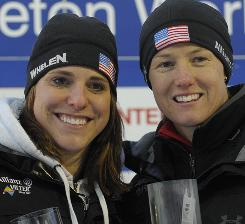 Shauna Rohbock, right, and brakewoman Michelle Rzepka pose during the winner ceremony Friday in Igls, Austria.