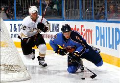The Thrashers' Maxim Afinogenov, right, controls the puck against the Ducks' Todd Marchant Tuesday night in Atlanta. Afinogenov scored the winning goal on a power play.