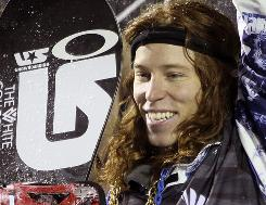 Shaun White takes the podium after winning the US Snowboarding Grand Prix on Friday in Park City, Utah.