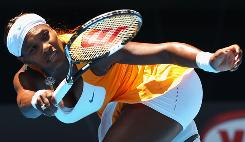 Serena Williams of the USA follows through on a forehand during her semifinal victory Wednesday (Tuesday night ET) against Li Na of China at the Australian Open in Melbourne.