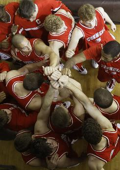 Cornell players huddle before the second half of the La Salle game last month in Philadelphia. Cornell won 78-75.