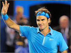 Roger Federer of Switzerland waves to the crowd as he celebrates his victory over Jo-Wilfried Tsonga of France in their men's semifinal match at the Australian Open in Melbourne on Friday. Federer won 6-2, 6-3, 6-2 to advance to the final against Andy Murray of Great Britain.