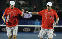 Bob and Mike Bryan celebrate a point with a fist bump during the men's doubles final in Melbourne.