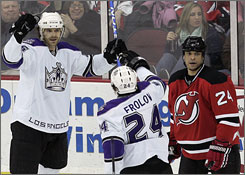 Michael Handzus, celebrating with Kings teammate Alexander Frolov, scored a goal to help Los Angeles reach its longest winning streak in eight years.
