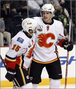 Defenseman Dion Phaneuf, right, had 10 goals, 12 assists and 49 penalty minutes with the Flames this season before being traded to the Maple Leafs.