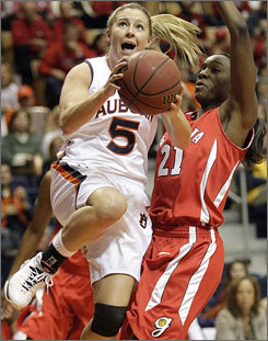 Auburn's Alli Smalley drives past No. 9 Georgia's Porsha Phillips during the first half. Smalley scored 22 points as the Tigers broke a four-game losing streak.