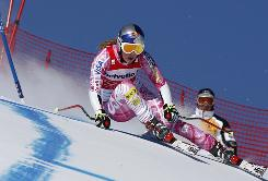 Lindsey Vonn takes a turn past a flag Sunday in St. Moritz, Switzerland.