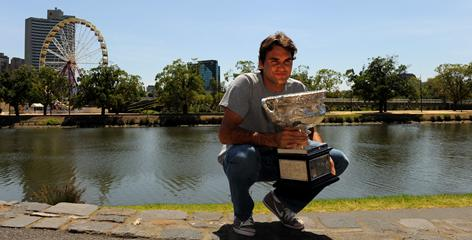 Roger Federer poses with his Australian Open trophy on the bank of the Yarra River in Melbourne on Monday, a day after capturing his 16th Grand Slam title.