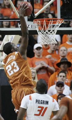 Texas guard Jordan Hamilton goes up for a dunk in front of Oklahoma State forward Matt Pilgrim during the second half. Hamilton ended with a career-high 27 points.
