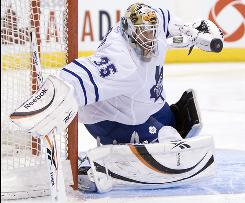 Toronto Maple Leafs goaltender Jean-Sebastien Giguere makes a save against the New Jersey Devils during the third period.