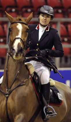 Switzerland's Martina Hingis and Whisky's Bon Ami compete during the Helvetia Amateur Price show jumping competition in Basel, Switzerland, on Jan. 15. Hingis, who said Tuesday she would play in World TeamTennis but not consider a return to the pro tour, has been competing in show jumping.