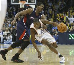 Oklahoma City Thunder forward Kevin Durant, right, drives around Atlanta guard Joe Johnson during the fourth quarter Tuesday night. Durant has scored at least 25 points in the last 22 games, matching Allen Iverson's record nine seasons ago.