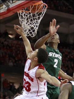 Wisconsin's Rob Wilson, left, scores against Michigan State's Raymar Morgan during the second half Tuesday night. Wilson scored 10 points, and went 5-for-5 from the free-throw line.