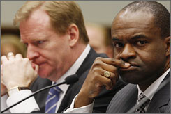 NFLPA chief DeMaruce Smith, right, is wading into a CBA battle with the NFL and commissioner Roger Goodell, left.