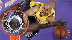 Lakers guard Derek Fisher, right, goes up for a shot as Bobcats center DeSagana Diop defends during the first half Wednesday night in Los Angeles. Fisher scored seven points.