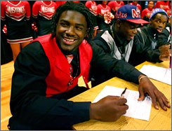 Ronald Powell, left, is joined by his Rancho Verde High School football teammates while he signs his letter of intent to Florida.