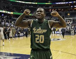 South Florida guard Dominique Jones celebrates the Bulls' 72-64 win over Georgetown at the Verizon Center in Washington. South Florida has extended its Big East winning streak to four.
