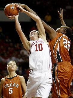 Texas' Ashley Gayle blocks the shot of Oklahoma's Carlee Roethlisberger. Texas never trailed during Wednesday's game.