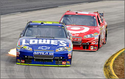 Jimmie Johnson (front) and Juan Pablo Montoya each raised their games during the 2009 NASCAR postseason. Johnson won his fourth straight title, and Montoya was in close pursuit until fading to eighth place in standings.
