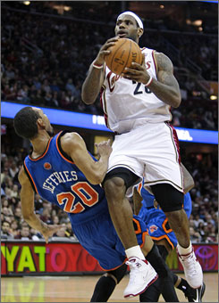 The Cavaliers' LeBron James, right, blowing past Knicks forward Jared Jeffries, scored 47 points including 24 consecutive for Cleveland in the first half.