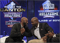 Jerry Rice, left, and Emmitt Smith share a moment after they were elected to the Hall of Fame. Both Rice and Smith were first-ballot selections.