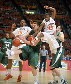 Illinois' Jeff Jordan (13) and Mike Davis (24) sandwich Michigan State's Garrick Sherman during the Fighting Illini's five-point triumph over the visiting Spartans.