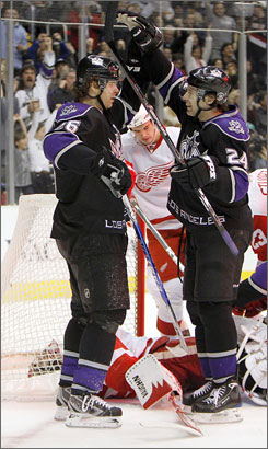 Michal Handzus, left, celebrates with teammate Alexander Frolov as the Kings overcame a 3-0 first-period deficit to stun the visiting Red Wings.