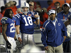Colts head coach Jim Caldwell, standing next to quarterback Peyton Manning during Super Bowl XLIV, said his team missed opportunities in the championship game.