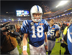 A dejected Peyton Manning walks off the field after the Colts lost Super Bowl XLIV to the Saints. Manning finished 31 of 45 for 333 yards, one touchdown and an interception that was returned for a score.